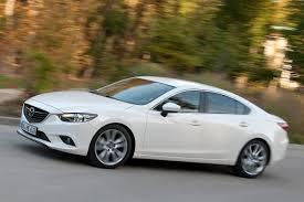 Là người em thân thiết với Mazda 3. Thật không ngạc nhiên nếu chúng có ngoại hình gần giống nhau.